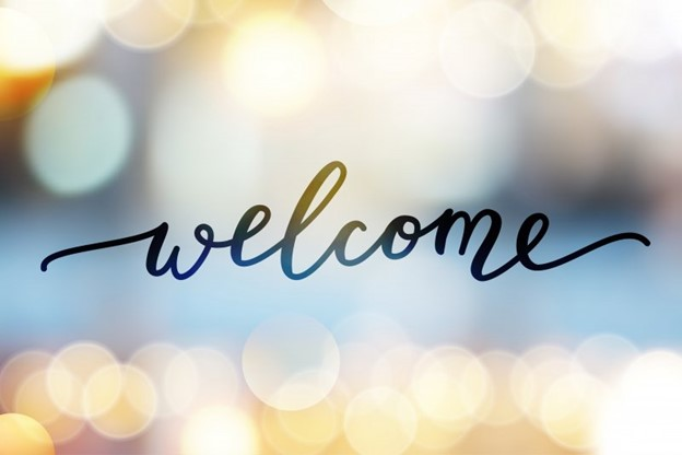 Welcome text with lights in the background